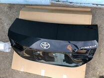 Крышка Toyota Corolla 180 багажника оригинал